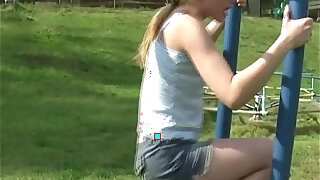 Young teen plays in the park with an increment of flashes her horde
