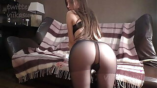 Slim Brown-haired In Black Pantyhose Shows Pussy